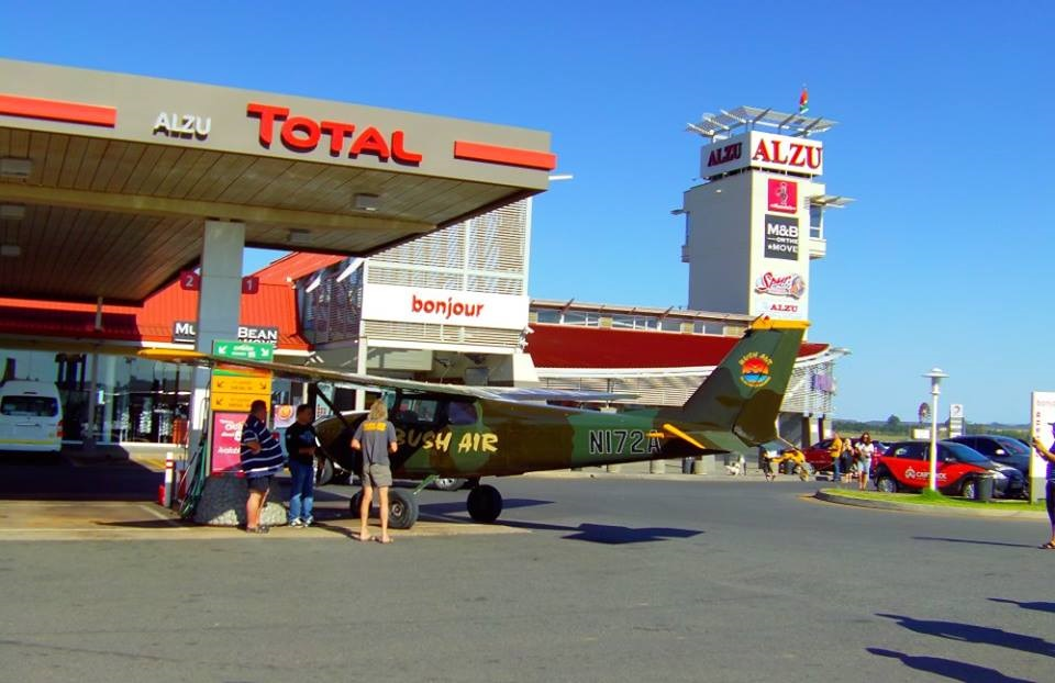 """CC"" Milne Pocock and his Cessna C172 at a gas station"